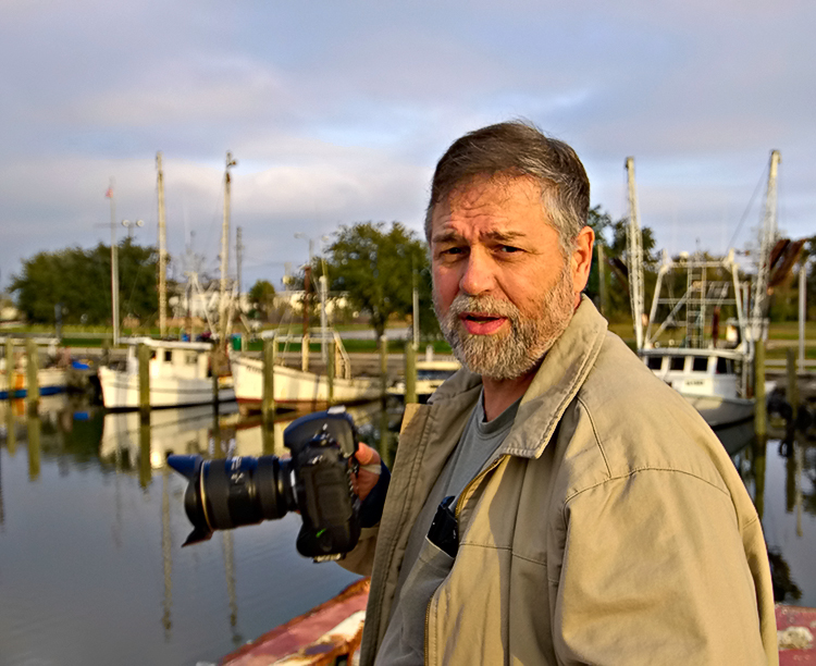 Mark Lindquist photographing in Appalachicola, FL.  Photo by John McFadden